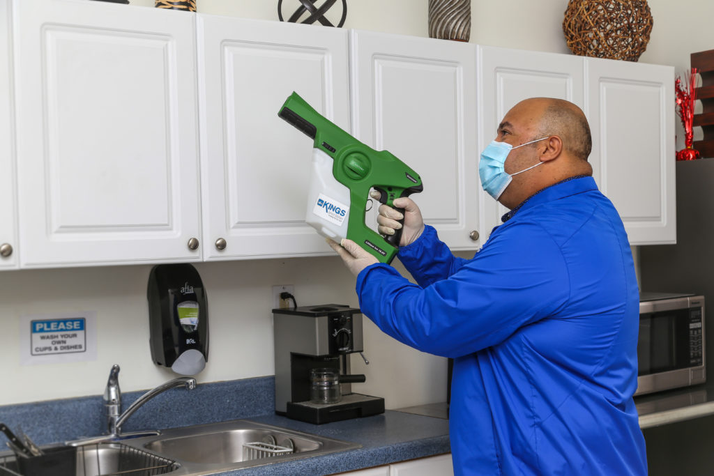 A man cleaning the kitchen drawers